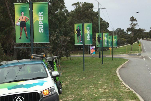 Large portrait vinyl banners mounted to flag posts along Whitfords Ave Craigie for the City of Joondalup